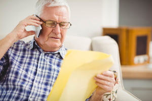 man on phone scams senior home care boston
