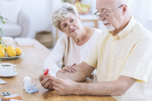 senior couple contemplating medications and supplements