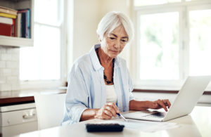 female baby boomer reviewing budget
