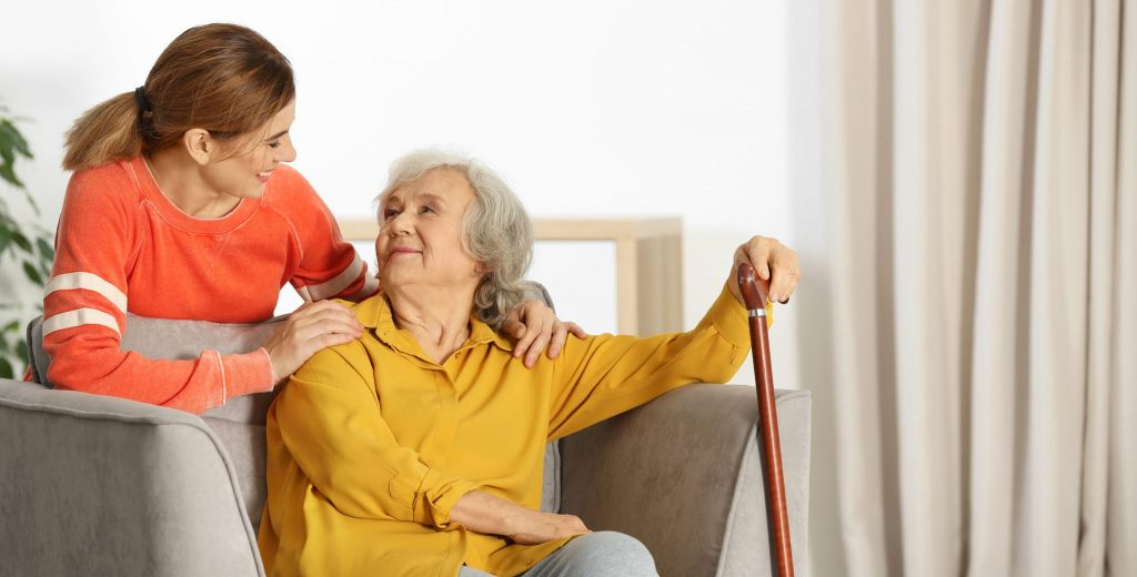 Kind personal care aide providing high-quality care that's well worth the cost of home care in Massachusetts