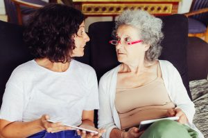 mom and daughter talk about the costs of in-home dementia care.